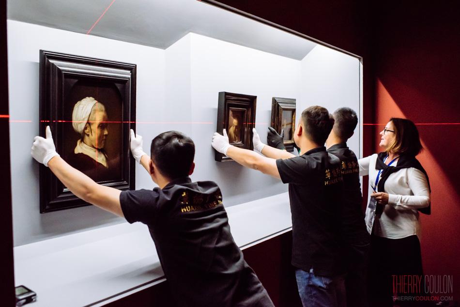 Masterpieces are ready to be hanged on a wall at The Leiden Collection Exhibition at Long Museum Shanghai Photographer Thierry Coulon