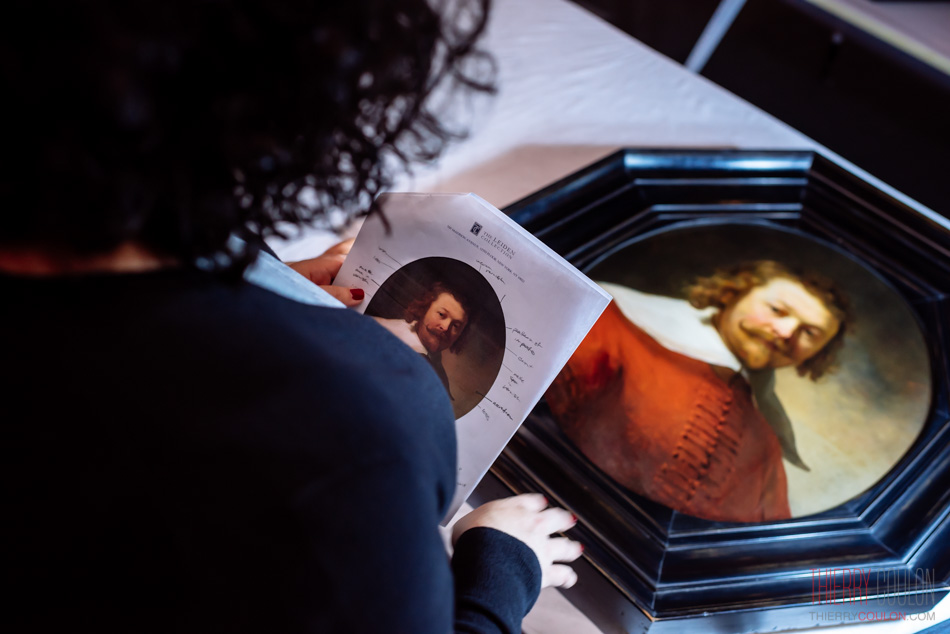 Sara C. Smith is checking a Rembrandt masterpiece at Shanghai Long Museum Photographer Thierry Coulon
